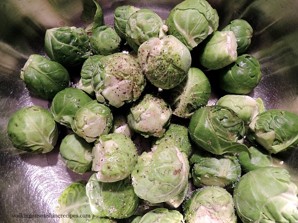 Toss the brussels sprouts with olive oil, salt and pepper.
