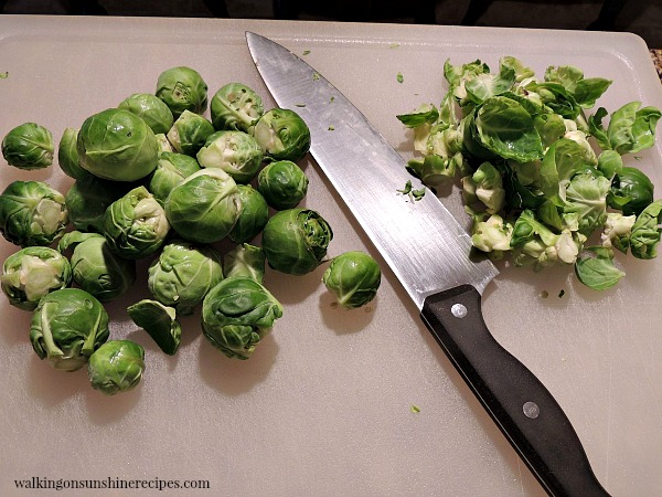 Trim the ends and remove the outer leaves from the brussels sprouts.