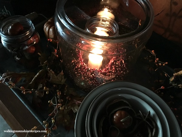 Candles in Glass Jars on Kitchen Hutch from Walking on Sunshine Recipes