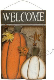 Welcome sign with pumpkins