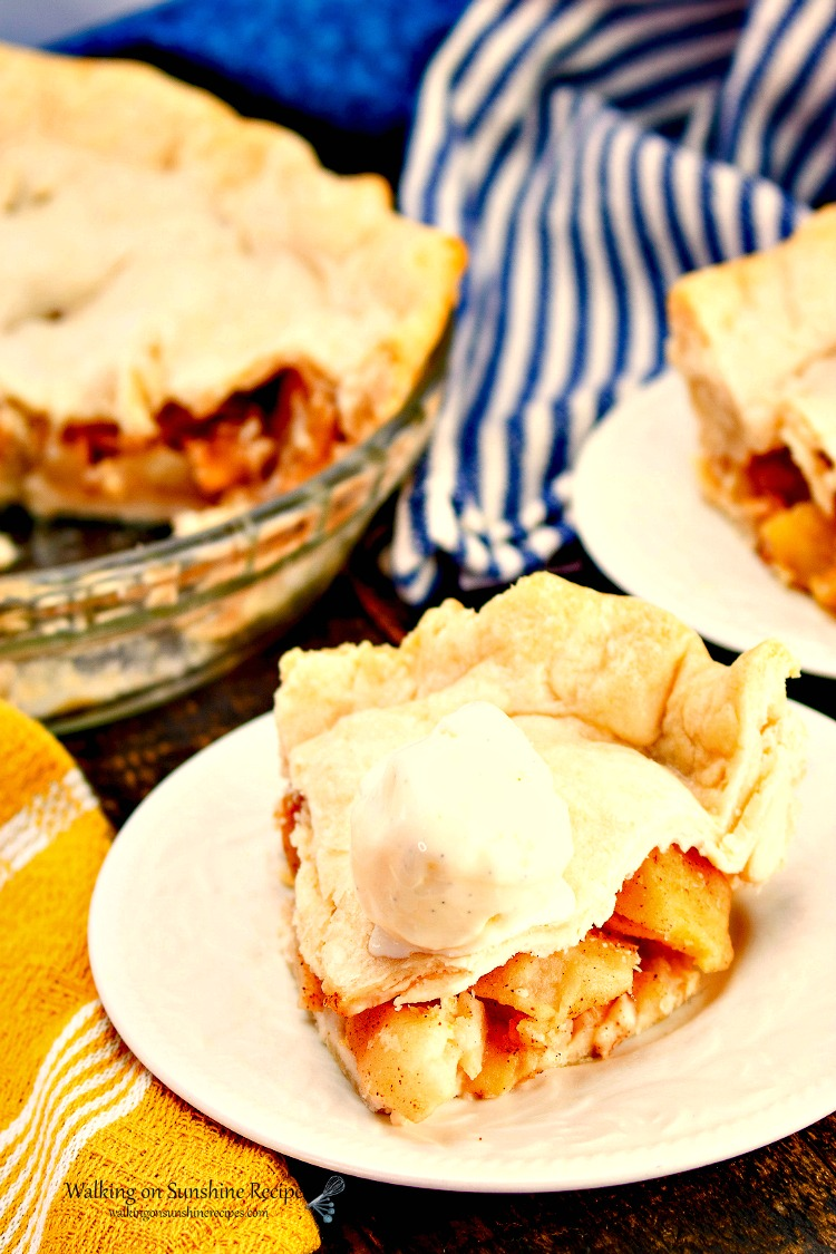 Apple Pie Sliced and served on plate with ice cream