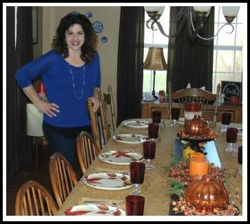 Me standing in front of my beautiful table set for Thanksgiving from Walking on Sunshine.
