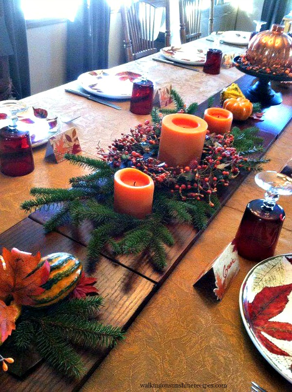 Bookshelves used down the center of the table for Thanksgiving centerpiece from Walking on Sunshine Recipes.