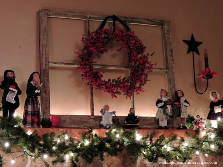Christmas Carolers decorating the mantel from Walking on Sunshine Recipes.