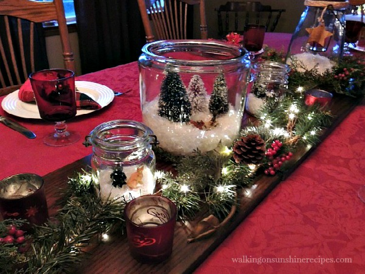 Christmas table set with terrariums and Christmas lights