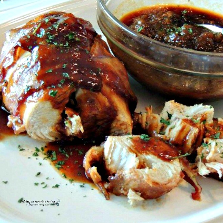 Bacon Wrapped Chicken on platter with apples and BBQ sauce in bowl