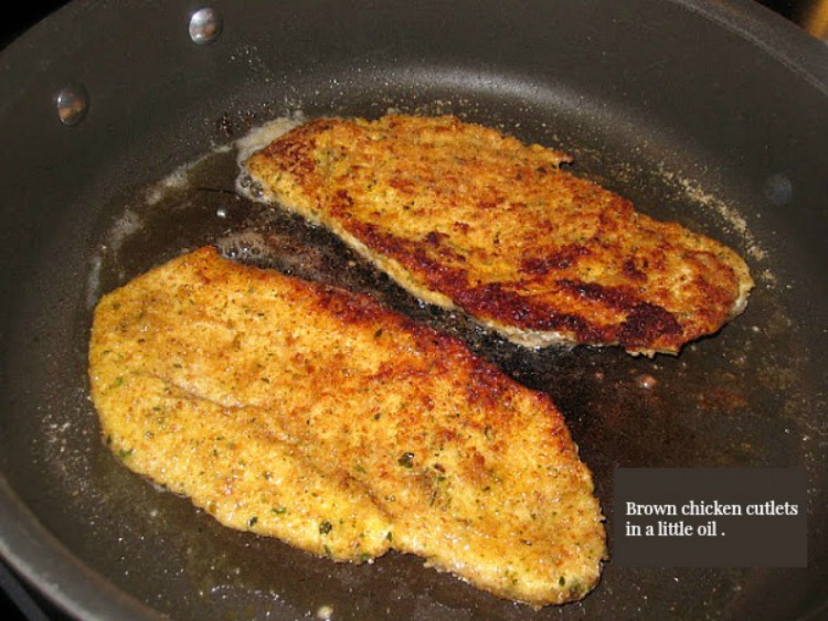 Breaded Chicken Cutlets in frying pan.