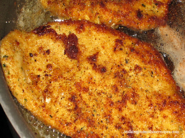 chicken cutlets baked in frying pan.