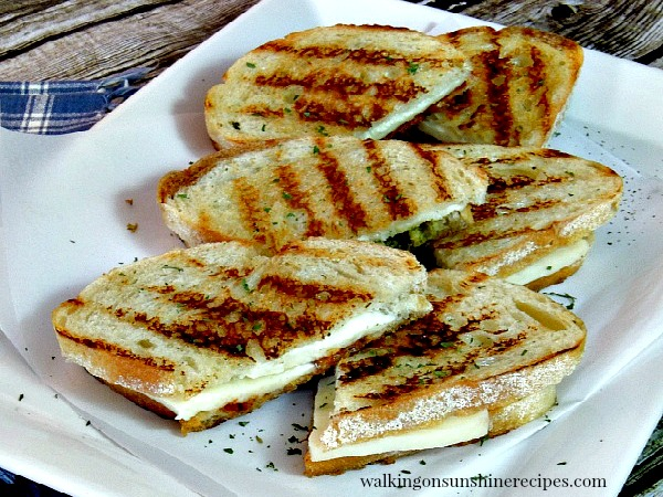 Grilled Panini Sandwiches on white platter from Walking on Sunshine