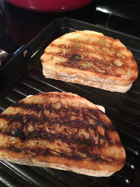 Grilled Pesto Panini Sandwiches cooking on grill pan from Walking on Sunshine.