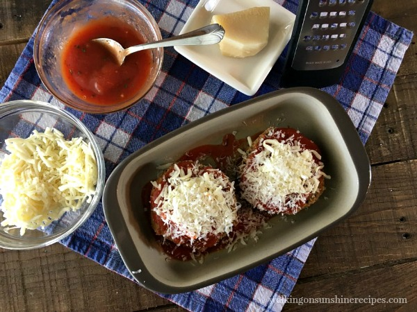Add Freshly Grated Parmesan Cheese to the Healthy Baked Eggplant Parmesan from Walking on Sunshine.