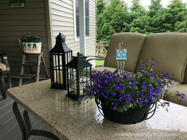 Back Porch at the Christensen's purple flowers black lanterns from Walking on Sunshine.