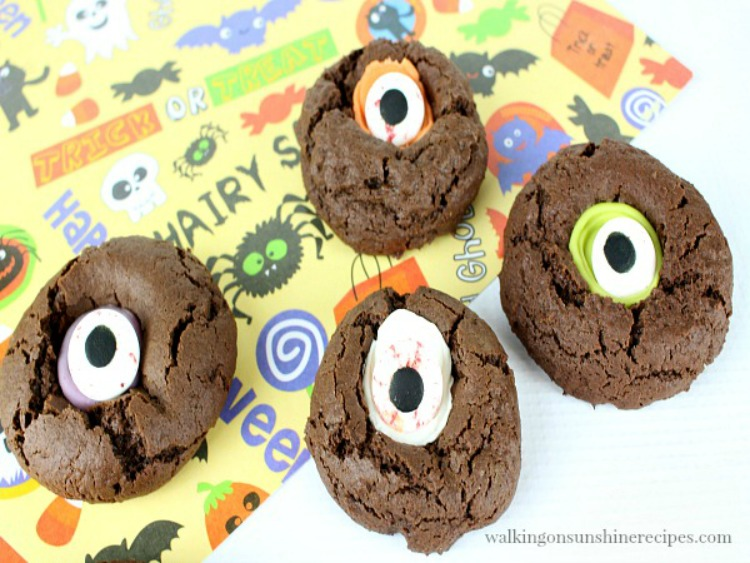 Fun Halloween chocolate thumbprint cookies with googly scary eyes.