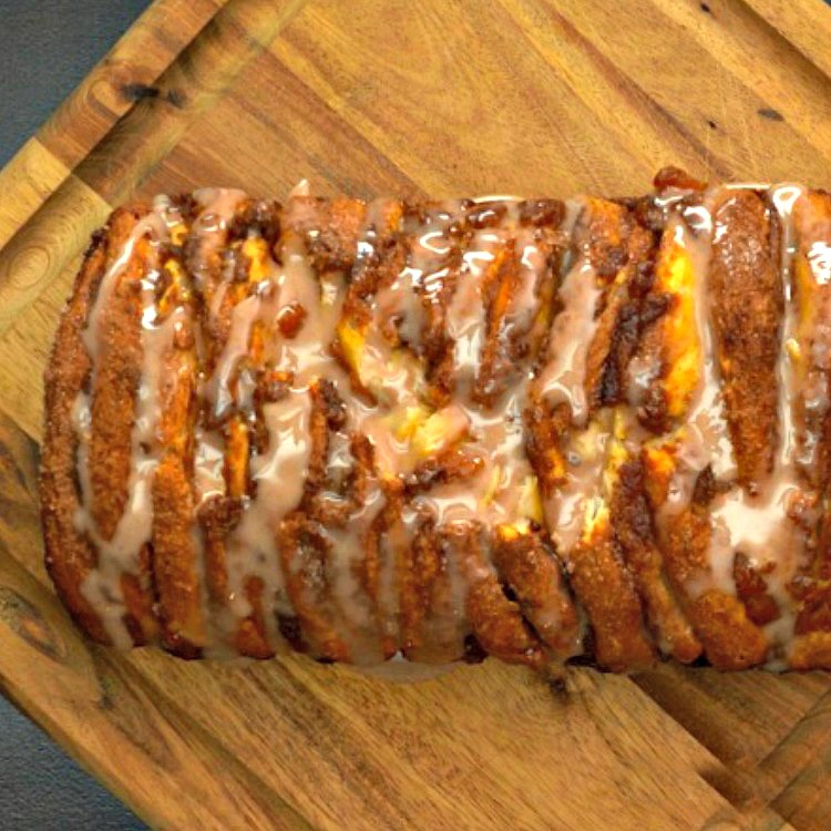 Pumpkin Spice Pull-Apart Bread Recipe with glaze on cutting board.
