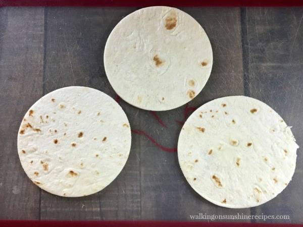 Lay the circle flour tortillas on a cutting board for Mummy Quesadillas from Walking on Sunshine Recipes
