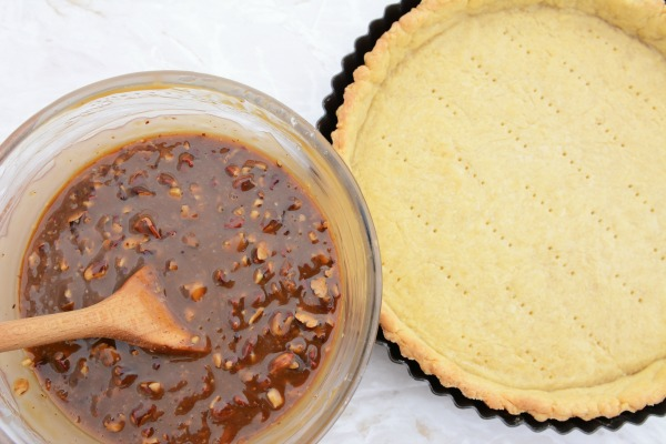 Add the pecans to the mixture for Pecan Pie from Walking on Sunshine Recipes.