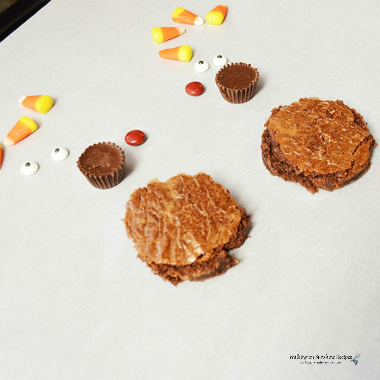 Assembling the Turkey Brownies with candy corn, peanut butter cups and candy eyes.