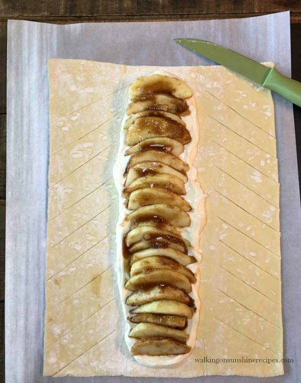 Make diagonal cuts in the puff pastry for the Apple Braid from Walking on Sunshine Recipes