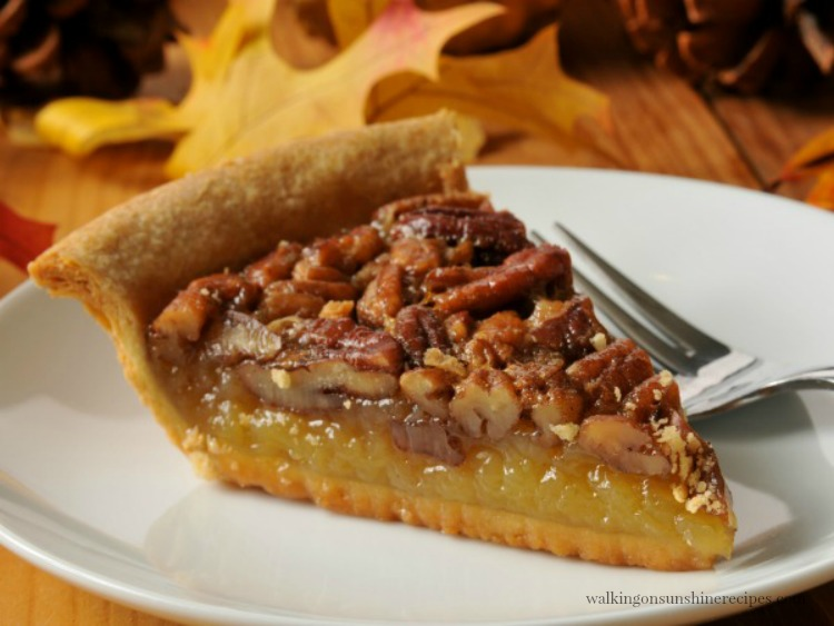 Homemade Pecan Pie on white plate.