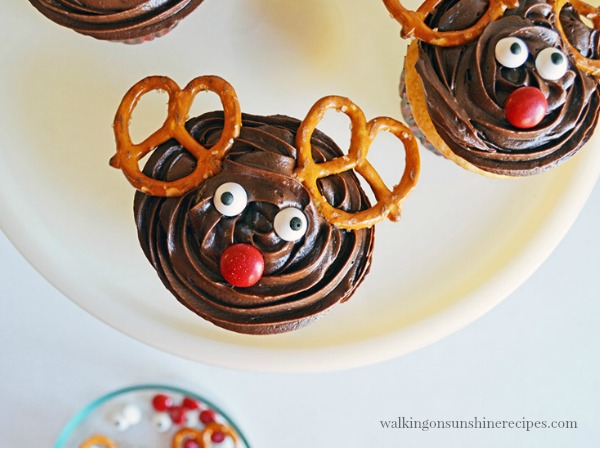Add the pretzels and candy eyes for Reindeer Cupcakes from Walking on Sunshine Recipes