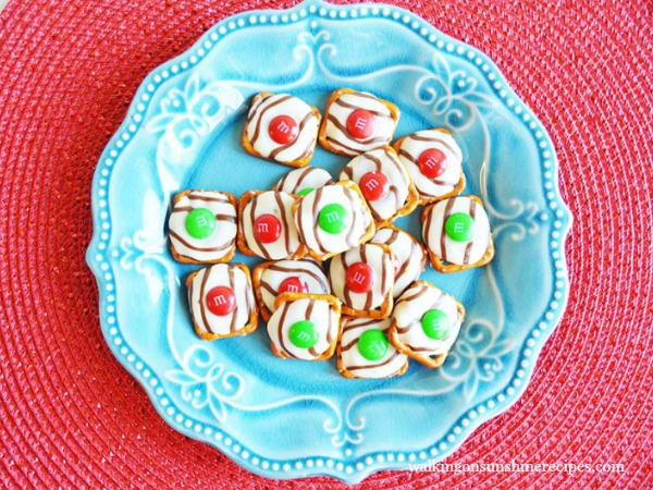 Hugs Pretzel Treats on blue plate from Walking on Sunshine Recipes.