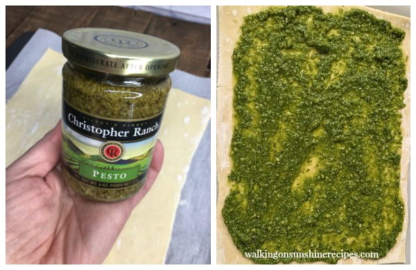 Spread the pesto on top of the bottom sheet of puff pastry from Walking on Sunshine Recipes.