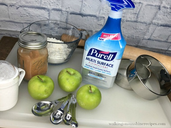 Purell Multi Surface Cleaner on cutting board with Baking Ingredients from Walking on Sunshine Recipes