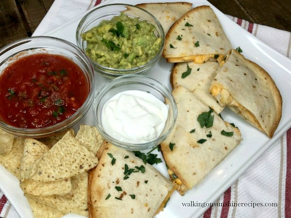 Cheesy Chicken Quesadillas on white platter with homemade salsa from Walking on Sunshine Recipes