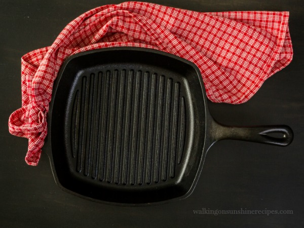 Square Cast Iron Grill Pan with Red Dish Towel.