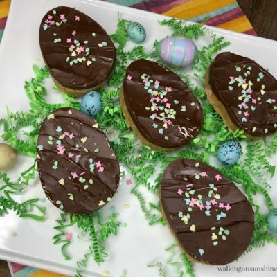 Chocolate Peanut Butter Eggs with confetti and plastic eggs on platter from Walking on Sunshine Recipes