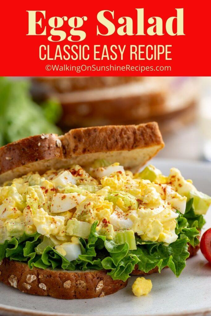 Egg salad sandwich on wheat bread with lettuce.