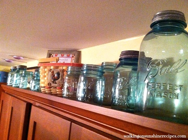 Antique Ball Jars on top of Kitchen Cabinets from Walking on Sunshine Recipes