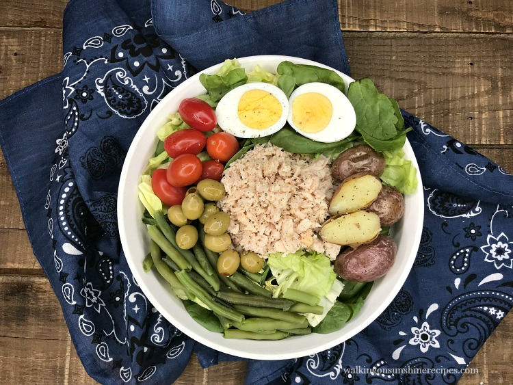 Canned Tuna Nicoise Salad with hard boiled eggs, red potatoes, grape tomatoes and green beans.