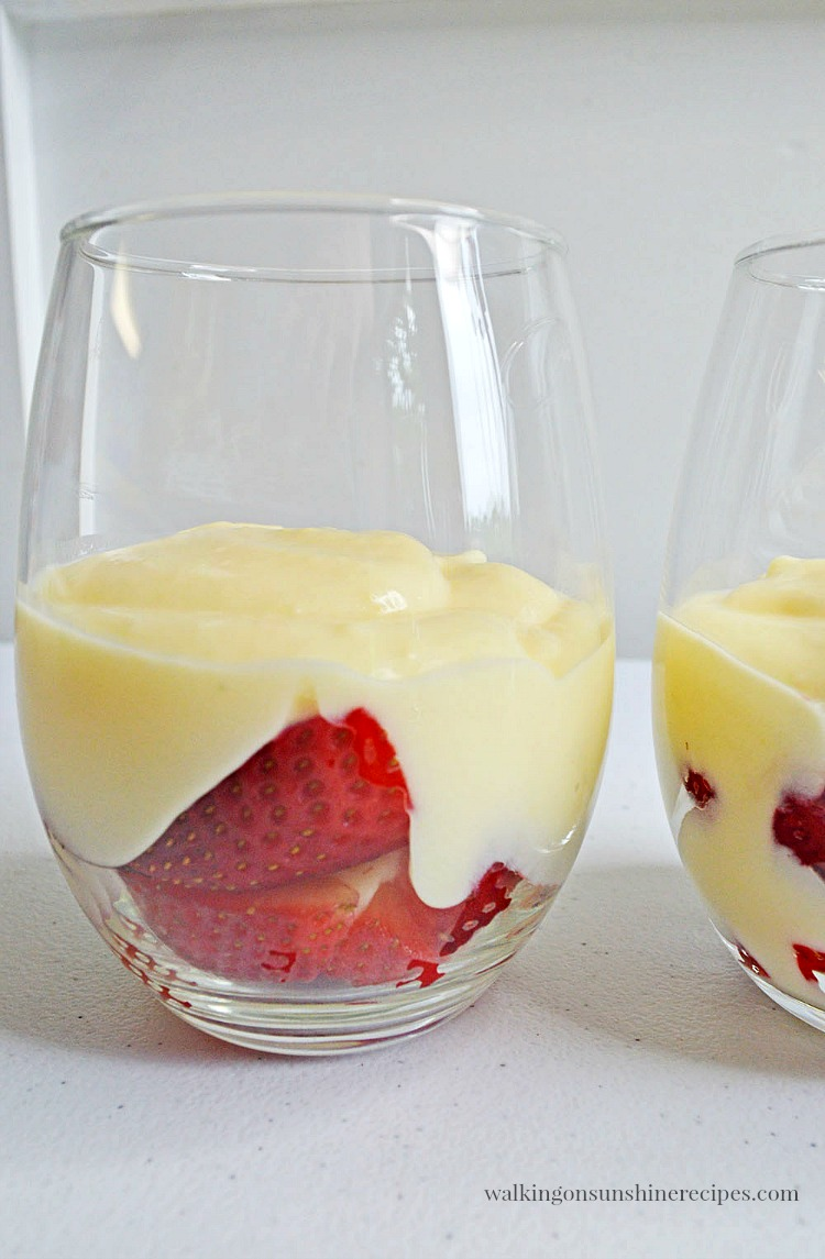 Add the pudding to the top of the strawberries for the Cheesecake Pudding Parfaits