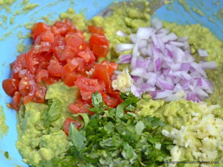 Chopped tomatoes, red onions, avocado for Homemade Guacamole