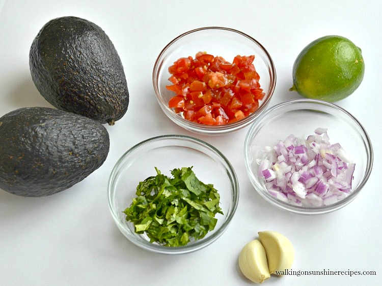 Avocado, chopped tomato, red onion, lime and garlic Ingredients for Homemade Guacamole from Walking on Sunshine Recipes