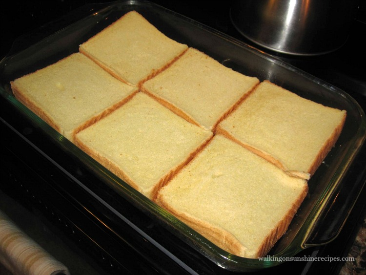 Bread slices dipped in egg for French Toast Casserole