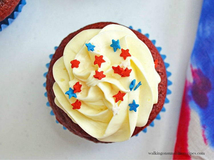 Red and Blue Sprinkle Stars on top of Homemade Red Velvet Cake with Vanilla Icing.