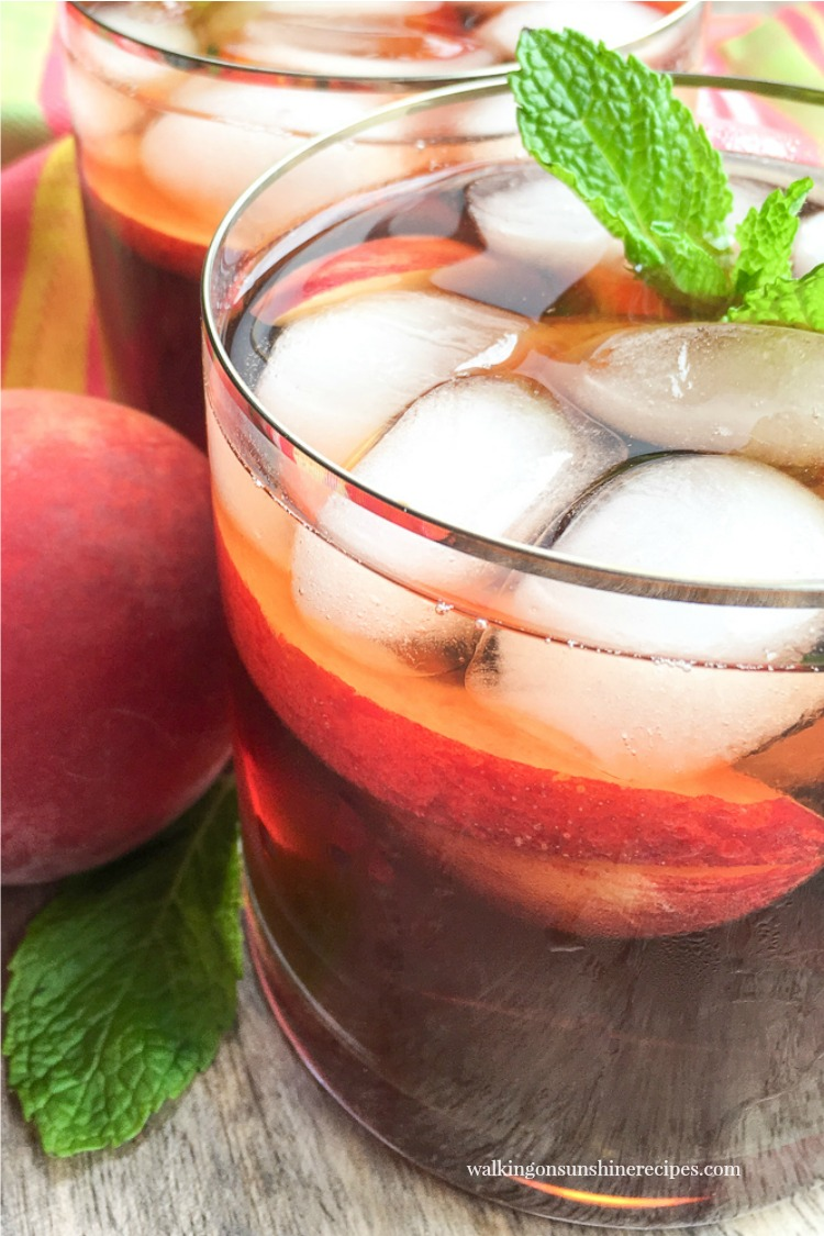 Homemade Peach Iced Tea with sprigs of fresh mint from Walking on Sunshine Recipes.