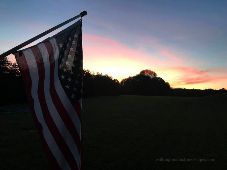 Sunset from the back porch with American Flag