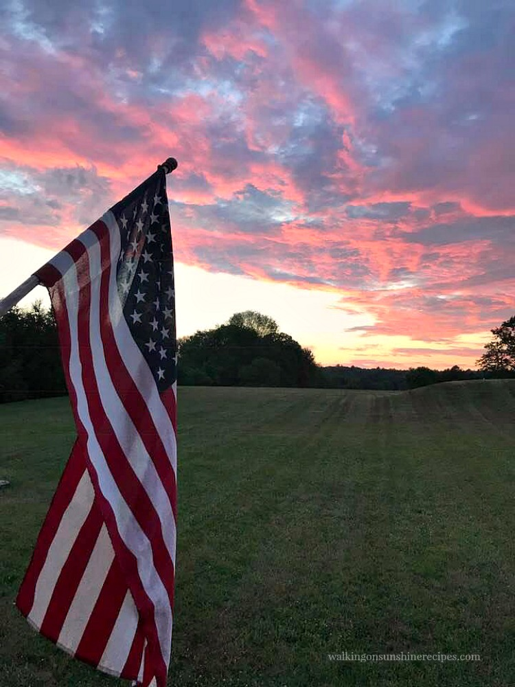 The View from our Summer Back Porch as the sun sets with American Flag.