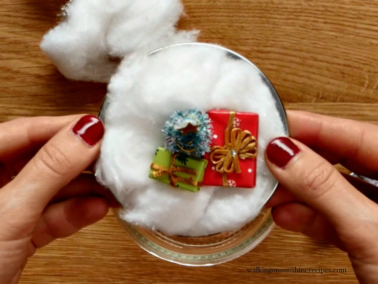Add craft ornaments to top of mason jar lid for Hot Chocolate Snow Globe