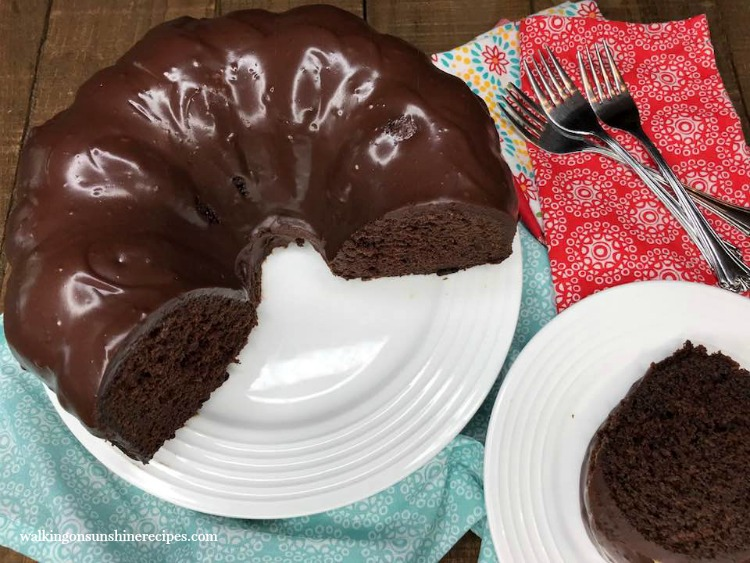 Chocolate Brownie Cake with Homemade Chocolate Glaze on white serving platter.