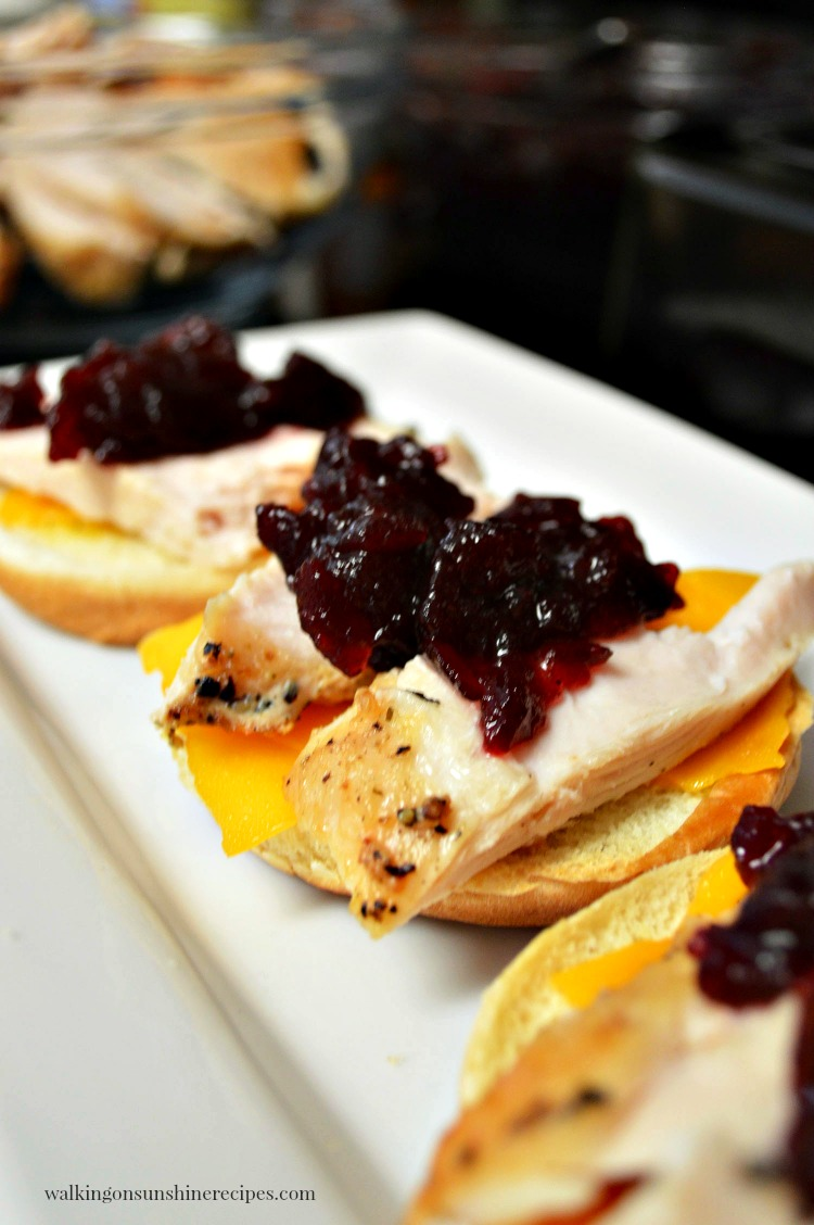 Top the leftover turkey slider sandwiches with cranberry sauce.