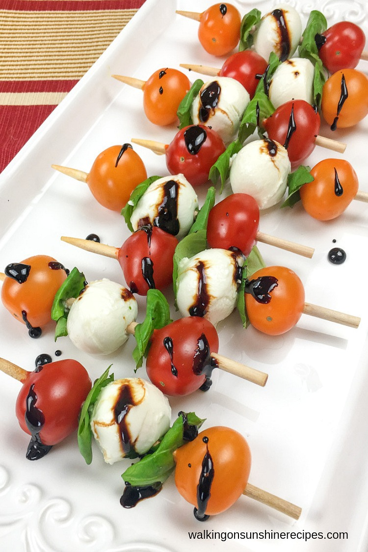 Drizzle the reduced balsamic vinegar glaze on top of the Caprese Antipasto Skewers just before serving.