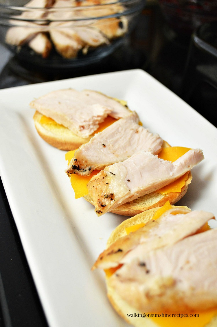 Add the turkey slices on top of the sliced cheddar cheese.