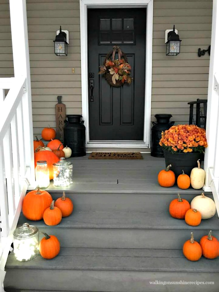 Front porch for Thanksgiving with twinkle lights from Walking on Sunshine Recipes