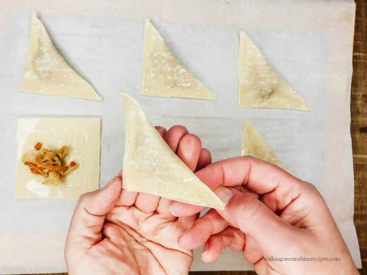 Fold the Wonton Wrappers in half to form triangles for Air Fryer Wontons Appetizers.