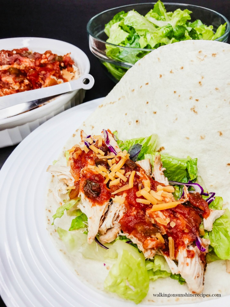Crock Pot Salsa Chicken served as burritos