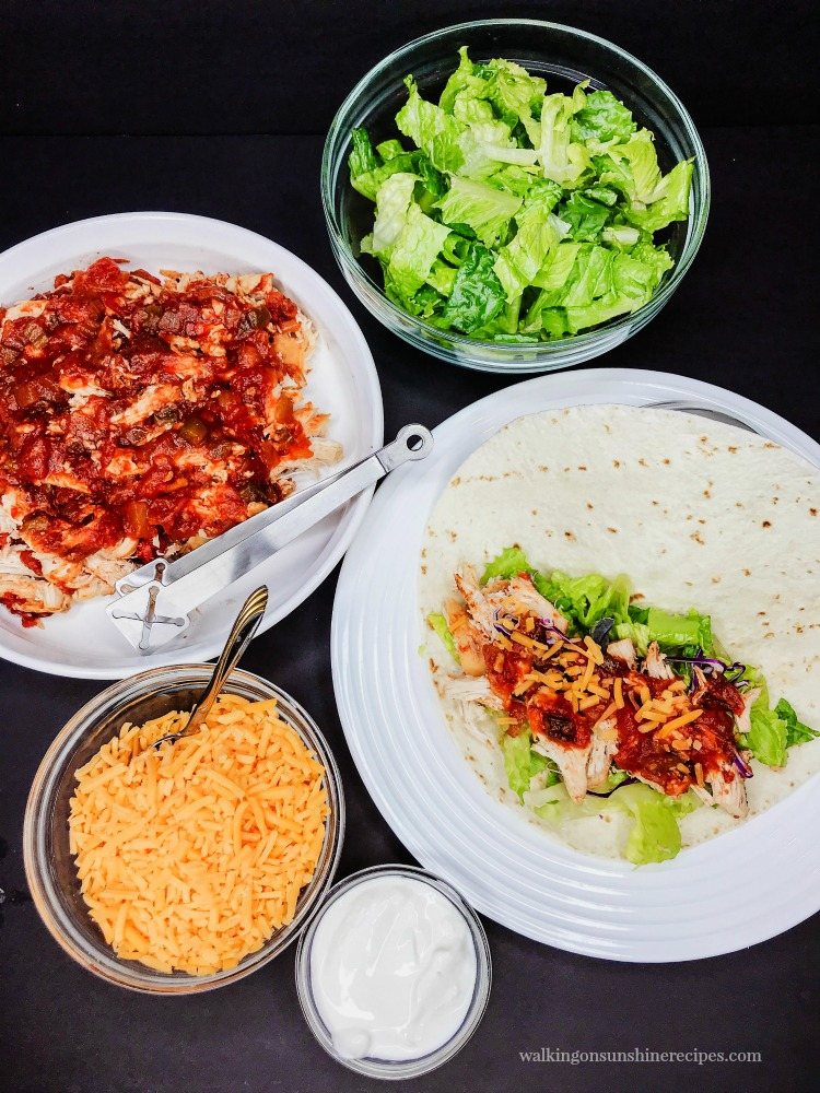 Crock Pot Salsa Chicken for dinner with lettuce, cheese and sour cream.